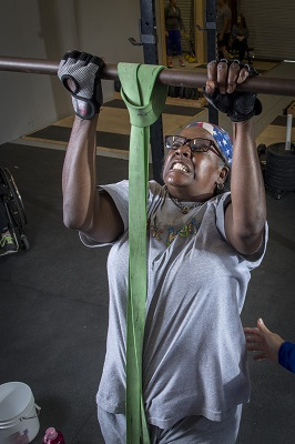 Veteran doing pullups for recreation therapy